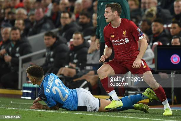 Napoli's Italian defender Giovanni Di Lorenzo reacts after clashing with Liverpool's English midfielder James Milner during the UEFA Champions league...