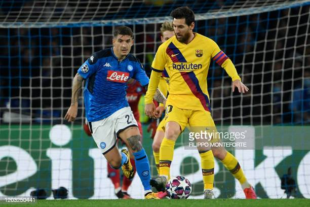 Napoli's Italian defender Giovanni Di Lorenzo vies for the ball with Barcelona's Argentine forward Lionel Messi during the UEFA Champions League...