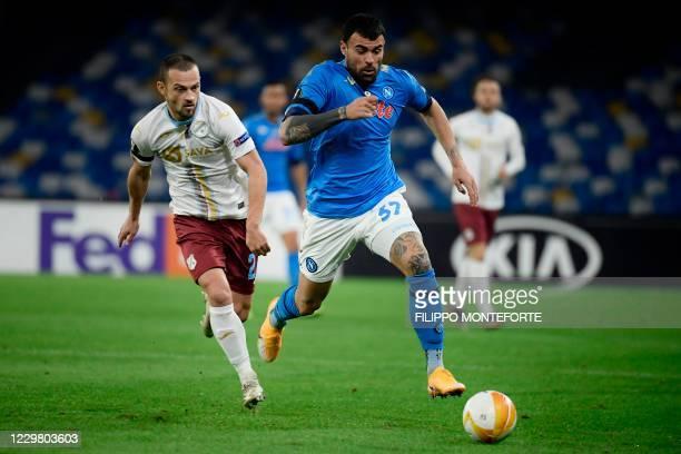 Napoli's Italian forward Andrea Petagna outruns Rijeka's Croatian defender Ivan Tomecak during the UEFA Europe League Group F football match Napoli...