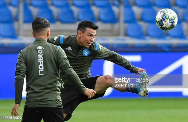 Napoli's Italian forward Lorenzo Insigne and Napoli's Mexican forward Hirving Lozano take part in a training session at the Fenix Stadium in Genk on...