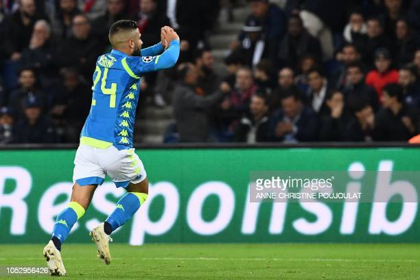 Napoli's Italian forward Lorenzo Insigne celebrates after scoring a goal during the UEFA Champions League Group C football match between Paris...