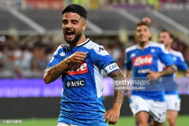 Napoli's Italian forward Lorenzo Insigne celebrates after scoring a penalty during the Italian Serie A football match Fiorentina vs Napoli on August...