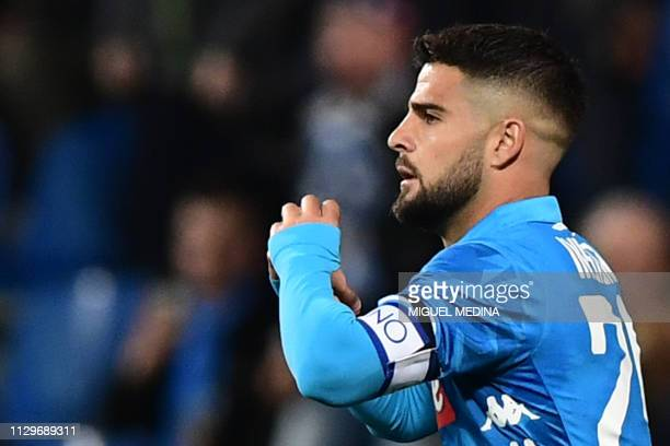 Napoli's Italian forward Lorenzo Insigne celebrates after scoring an equalizer during the Italian Serie A football match Sassuolo vs Napoli on March...