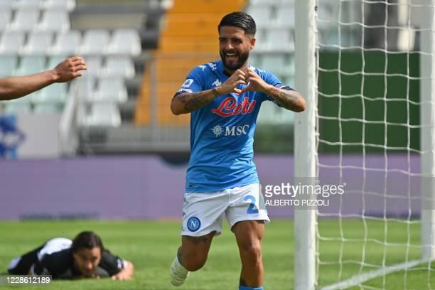 Napoli's Italian forward Lorenzo Insigne celebrates after scoring during the Italian Serie A football match Parma vs Napoli on September 20, 2020 at...