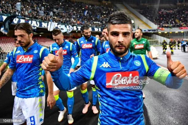 TOPSHOT Napoli's Italian forward Lorenzo Insigne celebrates after the UEFA Champions League group C football match between Napoli and Liverpool on...
