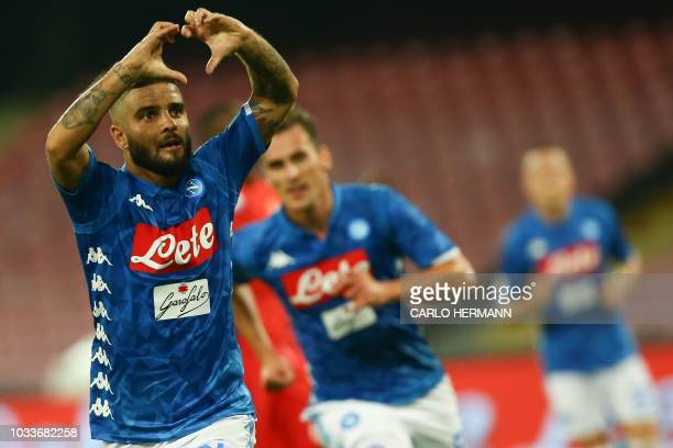 Napoli's Italian forward Lorenzo Insigne celebrates opening the scoring during the Italian Serie A football match Naples vs Fiorentina on September...
