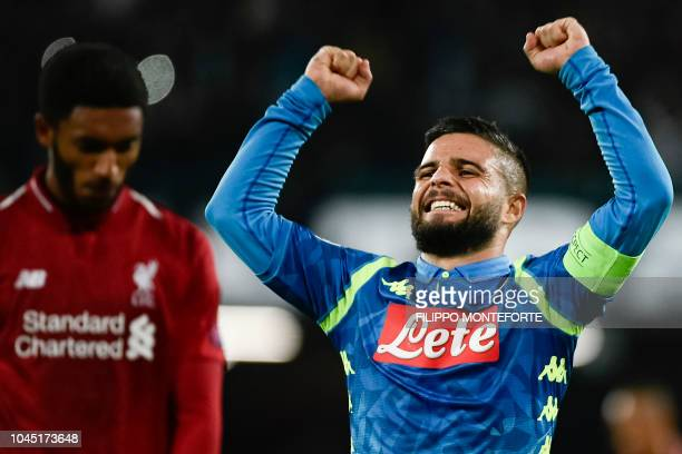 Napoli's Italian forward Lorenzo Insigne celebrates scoring next to Liverpool's English defender Joe Gomez during the UEFA Champions League group C...