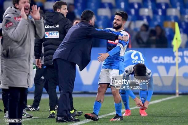 Napoli's Italian forward Lorenzo Insigne celebrates with Napoli's Italian head coach Gennaro Gattuso after scoring during the Italian Serie A...