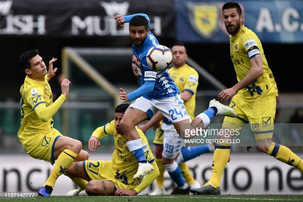 Napoli's Italian forward Lorenzo Insigne centres the ball during the Italian Serie A football match Chievo Verona vs Napoli on April 2019 at the...