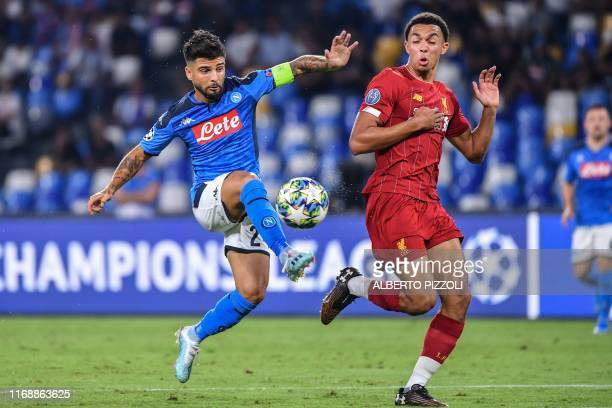 Napoli's Italian forward Lorenzo Insigne challenges Liverpool's English defender Trent AlexanderArnold during the UEFA Champions League Group E...