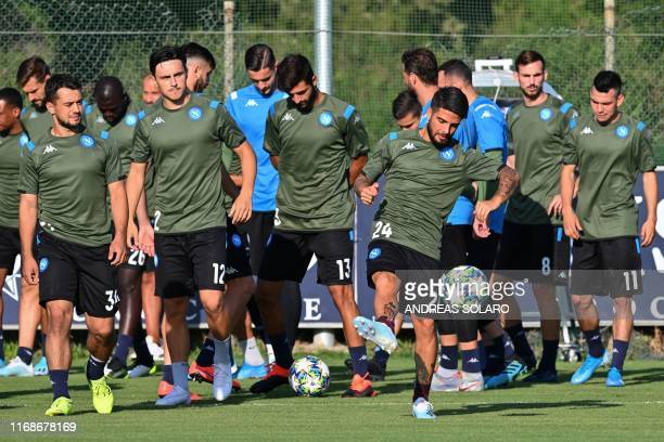 Napoli's Italian forward Lorenzo Insigne controls the ball during a training session at SSC Napoli training Center in Castel Volturno near Naples on...