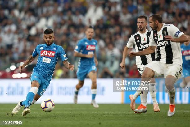 Napoli's Italian forward Lorenzo Insigne controls the ball during the Italian Serie A football match Juventus vs Napoli on September 29 2018 at the...