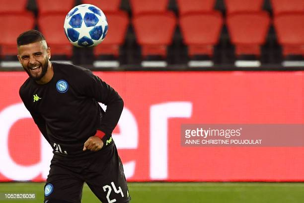 Napoli's Italian forward Lorenzo Insigne eyes the ball as he takes part in a training session at the Parc des Princes stadium in Paris on October 23...