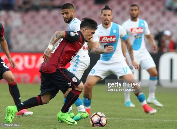 Napoli's Italian forward Lorenzo Insigne fights for the ball with Cagliari's Italian defender Fabio Pisacane during the Italian Serie A football...