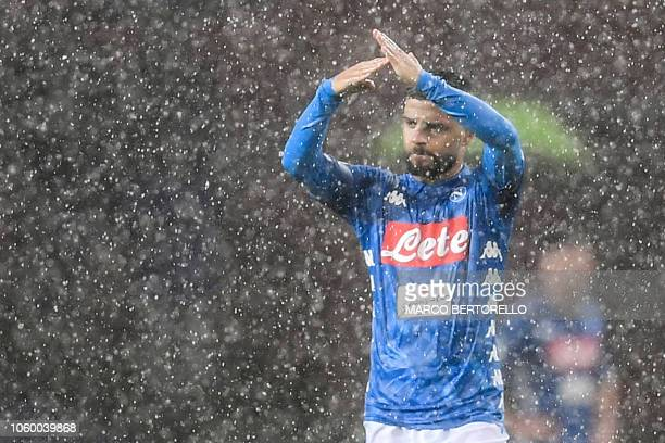 Napoli's Italian forward Lorenzo Insigne gestures to ask for an interruption because of heavy rain during the Italian Serie A football match Genoa vs...