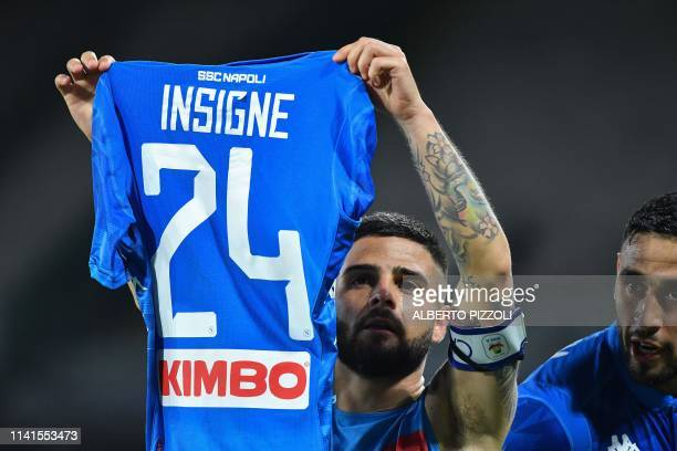 Napoli's Italian forward Lorenzo Insigne holds his tshirt to celebrate after scoring a penalty during the Italian Serie A football match between...