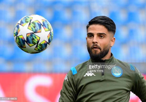 Napoli's Italian forward Lorenzo Insigne looks at the ball during a training session at the Fenix Stadium in Genk on October 1 2019 on the eve of the...