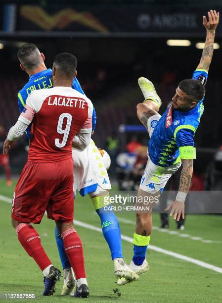 Napoli's Italian forward Lorenzo Insigne looses balance as he goes for the ball with Napoli's Spanish forward Jose Callejon and Arsenal's French...