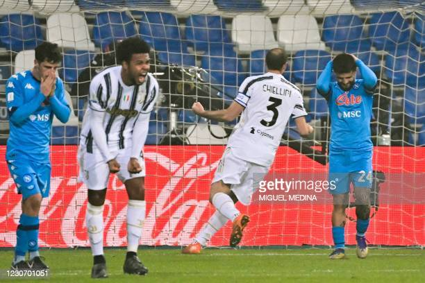 Napoli's Italian forward Lorenzo Insigne reacts after failing to score a penalty as Juventus' American midfielder Weston McKennie reacts in joy...