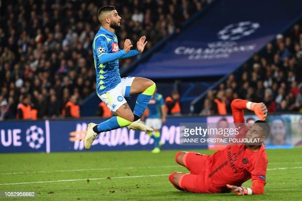 Napoli's Italian forward Lorenzo Insigne reacts as he shoots past Paris SaintGermain's French goalkeeper Alphonse Areola and scores during the UEFA...