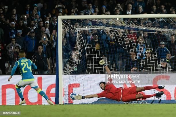Napoli's Italian forward Lorenzo Insigne scores a penalty kick despite Paris SaintGermain's Italian goalkeeper Gianluigi Buffon during the European...