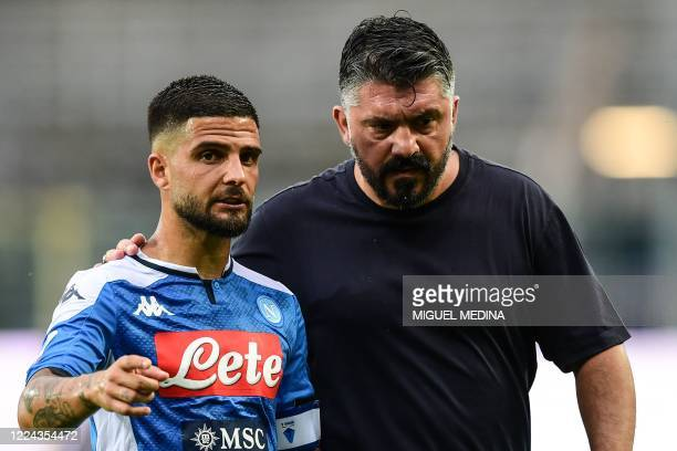 Napoli's Italian forward Lorenzo Insigne talks with Napoli's Italian head coach Gennaro Gattuso at half time during the Italian Serie A football...