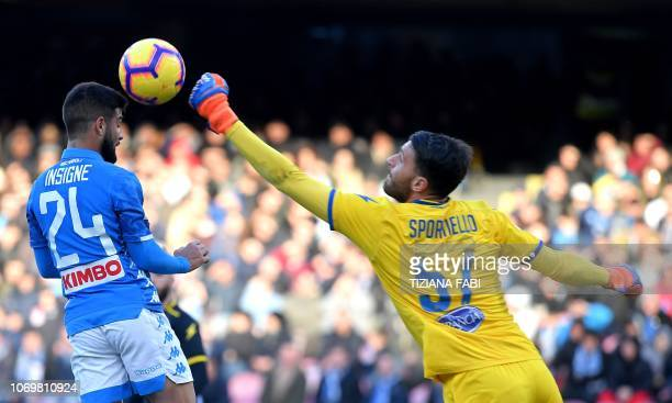 Napoli's Italian forward Lorenzo Insigne vies for the ball with Frosinone's goalkeeper Marco Sportiello from Italy during the Italian Serie A...