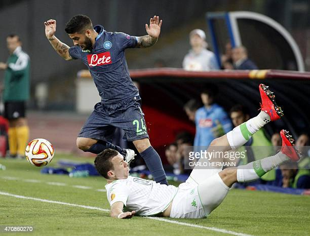 Napoli's Italian forward Lorenzo Insigne vies for the ball with Wolfsburg's Croatian midfielder Ivan Perisic during the UEFA Europa League quarter...