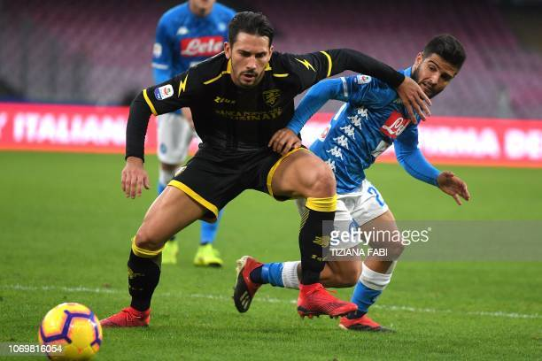 Napoli's Italian forward Lorenzo Insigne vies with Frosinone's Italian goalkeeper Marco Sportiello during the Italian Serie A football match between...