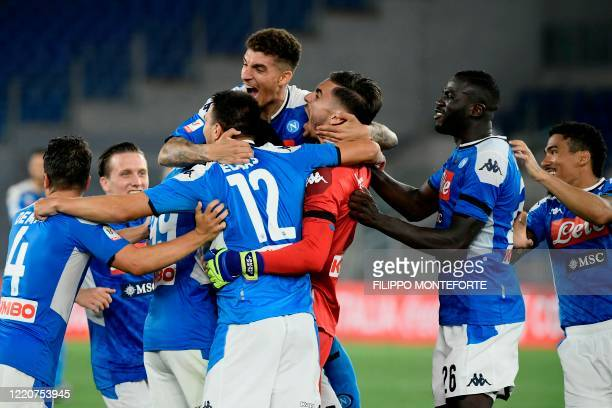 Napoli's Italian goalkeeper Alex Meret celebrates with teammates after Napoli won the TIM Italian Cup final football match Napoli vs Juventus on June...