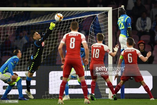 Napoli's Italian goalkeeper Alex Meret deflects a shot during the UEFA Europa League quarterfinal second leg football match Napoli vs Arsenal on...