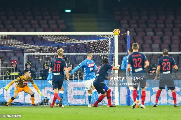 Napoli's Italian goalkeeper Alex Meret eyes the ball heading towards the goal post during the Italian Serie A football match Napoli vs Bologna on...