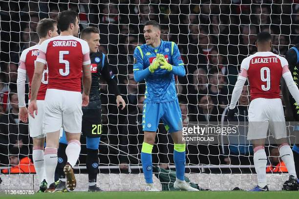Napoli's Italian goalkeeper Alex Meret gestures during the UEFA Europa League quarterfinal first leg football match Arsenal FC vs SSC Napoli at the...