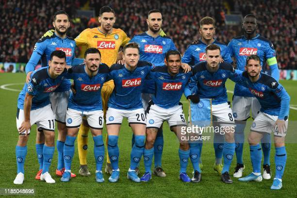Napoli's Italian goalkeeper Alex Meret pose for a photo with teammates ahead of the UEFA Champions league Group E football match between Liverpool...