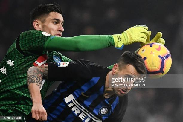 Napoli's Italian goalkeeper Alex Meret reaches out to grab the ball above Inter Milan's Uruguayan midfielder Matias Vecino during the Italian Serie A...