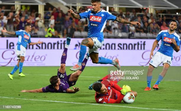 Napoli's Italian goalkeeper Alex Meret saves a ball under pressure from Fiorentina's Serbian forward Dusan Vlahovic as Napoli's Italian defender...