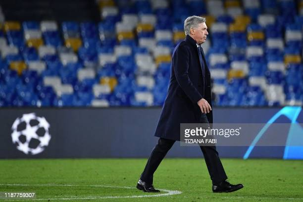 Napoli's Italian head coach Carlo Ancelotti goes to congratulate his players at the end of the UEFA Champions League Group E football match Napoli vs...