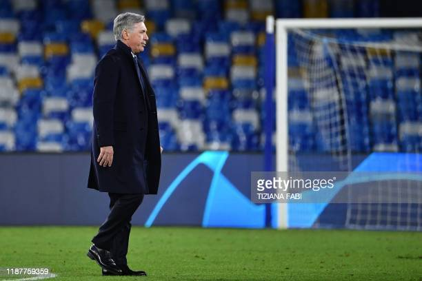 TOPSHOT Napoli's Italian head coach Carlo Ancelotti goes to congratulate his players at the end of the UEFA Champions League Group E football match...