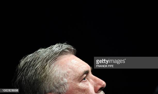 Napoli's Italian head coach Carlo Ancelotti looks on as he gives a press conference at the Parc des Princes stadium in Paris on October 23 2018 on...