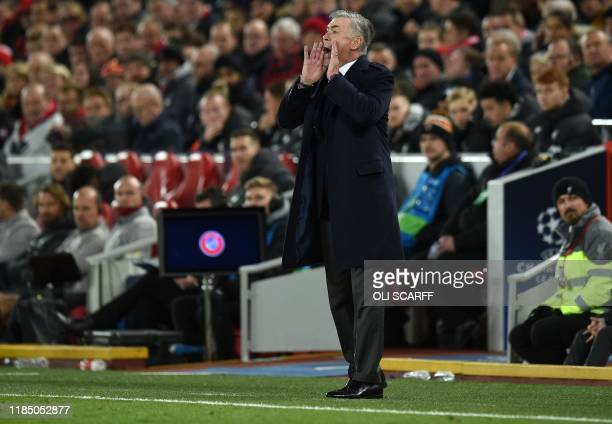 Napoli's Italian head coach Carlo Ancelotti shouts instructions to his players from the touchline during the UEFA Champions league Group E football...