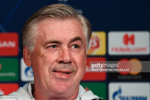 Napoli's Italian headcoach Carlo Ancelotti reacts as he gives a press conference at the Parc des Princes stadium in Paris on October 23 2018 on the...