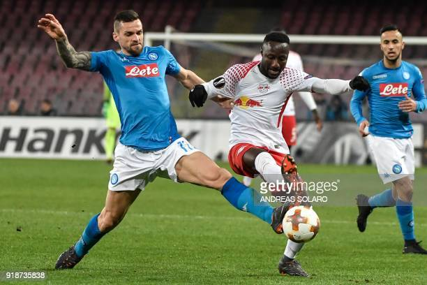 Napoli's Italian midfielder Christian Maggio vies for the ball with Leipzig's Guinean midfielder Naby Keita during the UEFA Europa League football...