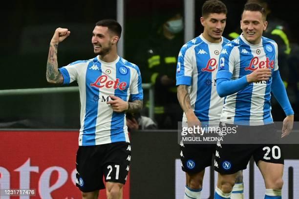 Napoli's Italian midfielder Matteo Politano celebrates next to Napoli's Polish midfielder Piotr Zielinski and Napoli's Italian defender Giovanni Di...