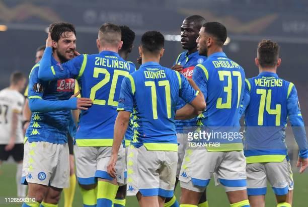 Napoli's Italian midfielder Simone Verdi celebrates with Napoli's Polish midfielder Piotr Zielinski Napoli's Algerian forward Adam Ounas Napoli's...