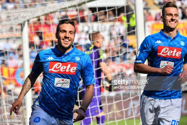 Napoli's Italian midfielder Simone Verdi celebrates with Napoli's Polish forward Arkadiusz Milik after scoring during the Italian Serie A football...