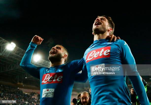 TOPSHOT Napoli's Italian striker Lorenzo Insigne and Napoli's Belgian striker Dries Mertens celebrate at the end of the Italian Serie A football...