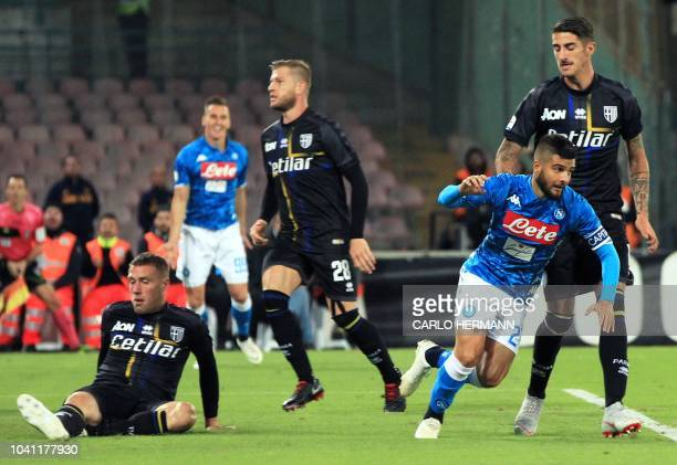 Napoli's Italian striker Lorenzo Insigne celebrates after scoring a goal during the Italian Serie A football match between SSC Napoli and Parma...