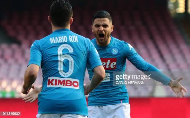 Napoli's Italian striker Lorenzo Insigne celebrates after scoring a goal with teammate Napoli's Portuguese defender Mario Rui during the Italian...