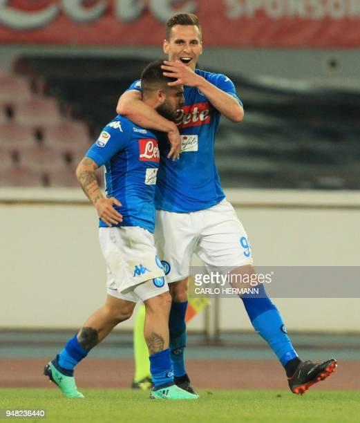 Napoli's Italian striker Lorenzo Insigne celebrates with teammate Napoli's Polish striker Arkadiusz Milik after scoring a goal during the Italian...