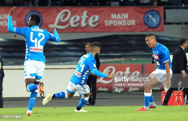 Napoli's Italian striker Lorenzo Insigne celebrates with teammates after scoring a goal during the Italian Serie A football match between SSC Napoli...